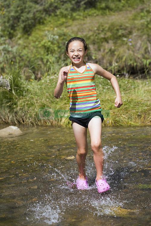 July 21, 2019 - Girl Running In Water (Credit Image: © Carson Ganci/Design Pics via ZUMA Wire)