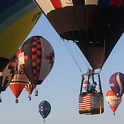 Johnny Petrehn, USA, (front) and other hot air balloons in the skies around rural Michigan near Battle Creek during competition in the 20th FAI World Hot Air Ballooning Championships. Battle Creek, Michigan, USA. 23rd August 2012. Photo Tim Clayton