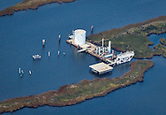 Aerial view of an abandoned oil and gas  faciltiy in Plaquemines Parish where land loss due to coastal erosion is estimated to be more than the size of footaball field every hour.