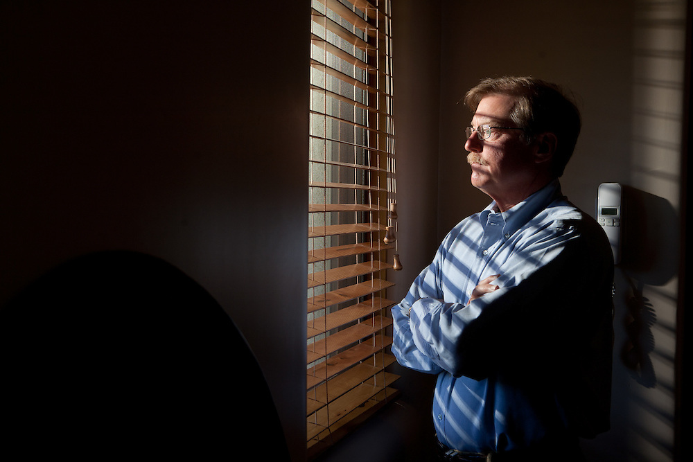 Former Merrill Lynch executive James A. Brown looks out the window of his Santa Fe New Mexico home on October 15, 2010...Credit: Steven St. John for The Wall Street Journal.ENRON