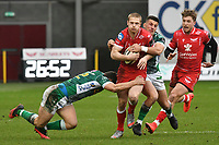 Rugby Union - 2020 / 2021 Guinness PRO14 - Round 12 - Scarlets vs Benetton - Parc-y-Scarlets<br /> <br /> Johnny McNicholl of Scarlets  tackled by Luca Morisi of Benetton & Leonardo Sarto of Benetton<br /> <br /> COLORSPORT/WINSTON BYNORTH