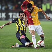 Galatasaray's Arda TURAN (R) and Fenerbahce's Selcuk SAHIN (L) during their Turkish superleague soccer derby match Galatasaray between Fenerbahce at the AliSamiYen Stadium at Mecidiyekoy in Istanbul Turkey on Sunday, 28 March 2010. Photo by TURKPIX