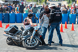 A demo for picking up a dropped bike at the Harley-Davidson footprint during the 75th Annual Sturgis Black Hills Motorcycle Rally.  SD, USA.  August 5, 2015.  Photography ©2015 Michael Lichter.
