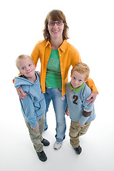Portrait of a mother with her little boys in the studio,