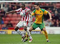 Photo: Paul Thomas.<br /> Stoke City v Norwich City. Coca Cola Championship. 28/10/2006.<br /> <br /> Ricardo Fuller (L) of Stoke keeps the ball from Jason Shackell.