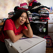 Vanessa Mae Rodel, 42, reflects as she packs up  her home in Hong Kong, on March 21, 2019, ahead of her move to Canada. / Photo: Maria de la Guardia