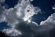Sunbursts through clouds