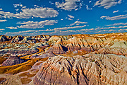 "The Painted Desert is a spectacular badlands running from near the east end of Grand Canyon National Park southeast into the Petrified Forest National Park. The desert is about 120 miles (190 km) long by about 60 miles (97 km) wide, making it roughly 7,500 square miles (19,425 km2) in area.  The view shown here is from the north portion of The Petrified Forest National Park. The Painted Desert is known for its brilliant and varied colors, including the unusual shades of lavender evident in this photograph.  <br /> <br /> The area resides within a strong rain shadow, giving it a cold desert climate with hot, dry summers and cold, virtually snow-free winters. The annual precipitation is the lowest in northern Arizona and in many places is lower even than Phoenix.<br /> <br /> The desert is composed of stratified layers of easily erodible siltstone, mudstone, and shale of the Triassic Chinle Formation. These fine-grained rock layers contain abundant iron and manganese compounds which provide the pigments for the various colors of the region. The erosion of these layers has resulted in the formation of the characteristic badlands topography of the region. Numerous layers of silicic volcanic ash occur in the Chinle and provide the silica for the petrified logs of the area. An assortment of fossilized prehistoric plants and animals are also found in the region, as well as dinosaur tracks and evidence of early human habitation.<br /> <br /> Desert was named by an expedition under Francisco Vázquez de Coronado on his 1540 quest to find the Seven Cities of Cibola, which he located some forty miles east of The Petrified Forest National Park. Finding that the cities were not made of gold as expected, Coronado sent an expedition to find the Colorado River to resupply his group. Passing through the wonderland of colors, they named the area ""El Desierto Pintado"", The Painted Desert."