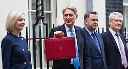 London, November 22 2017. Chancellor Philip Hammond poses with the famous red briefcase outside his official residence at 11 Downing Street ahead of delivering his budget speech in the House of Commons.. © Paul Davey