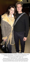 TV presenter BEVERLEY TURNER and her fiancee rower JAMES CRACKNELL, at a party in London on 11th December 2001.OWE 14