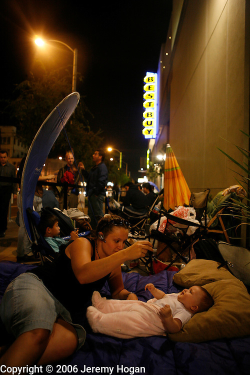 A woman and her four-month-old daughter Eva camp outside the Best Buy at the corner of La Brea and Santa Monica Boulevard while waiting at the front of the line for a Play Station 3. The woman has been waiting since Tuesday.