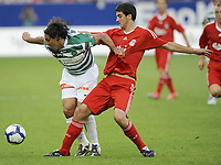 Mels, Switzerland FC St Gallen v  Liverpool Friendly 15/07/2009 <br /> Mario Caceres (St Gallens) gets to grips with Miguel San Jose (Liverpool) Photo Melanie Duchene  Fotosports International / EQI * UK only