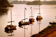 Tours, Loire, France, July 2006. The ancient fishing boat replicas on the Loire in front of Brehemont. The best way to experience the Loire region is by bike. The 'Loire a Velo' trail leads through ancient villages with medieval castles, fields of wheat and sunflowers, vineyards and wine producers in the region. Photo by Frits Meyst/Adventure4ever.com