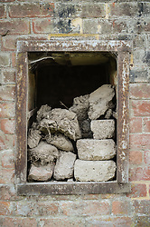 Rubble in a window in a building at Seagram's Farm in Imber village on Salisbury Plain, Wiltshire, where residents were evicted in 1943 to provide an exercise area for US troops preparing to invade Europe. Roads through the MoD controlled village are now open and will close again on Monday August 22.