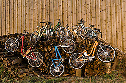 Electric bicycles on stack of firewood, Bavaria, Germany