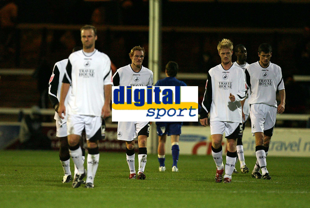 Photo: Rich Eaton.<br /> <br /> Peterborough United v Swansea City. Johnstone's Paint Trophy. 31/10/2006. dejected Swansea City players trudge off after their 1-0 defeat away at Peterborough