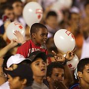 A young Vasco fan in the crowd as Vasco fans support their team during the Fluminense FC V CR Vasco da Gama Futebol Brasileirao League match at the Maracana, Jornalista Mário Filho Stadium, Rio de Janeiro,  Brazil. 22nd August 2010. Photo Tim Clayton.