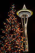 A colorful Christmas tree mimics the shape of the Space Needle on the Seattle Center grounds in Seattle, Washington.