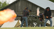 Members of Taylor's Battery demonstrate the firing of a civil war canon during the Bensenville Park District's annual Civil War Reenactment Weekend Sunday at Fischer Farm to answer questions from visitors.