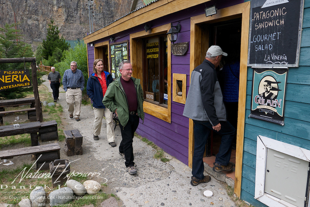 The crew are all smiles as Tanya leads them to one of her favorite places in Patagonia, the La Vineria wine bar in El Chalten, Argentina.