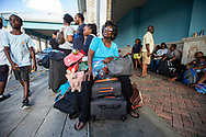 Hundreds of people were gathered outside the Leonard M. Thompson International Airport in Abaco. on Thursday hoping to be evacuated off the island after Hurricane Dorian swept through the Bahamas. Relief flights are taking out the elderly and sick, but many say an air-bridge will be required to move all of those who want to leave the hard-hit northern islands of the Bahamas.