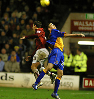 Photo: Dave Linney.<br />Walsall v Shrewsbury Town. Coca Cola League 2. 26/12/2006.Back to back action between Walsall's Kris Taylor(L) and  Michael Symes