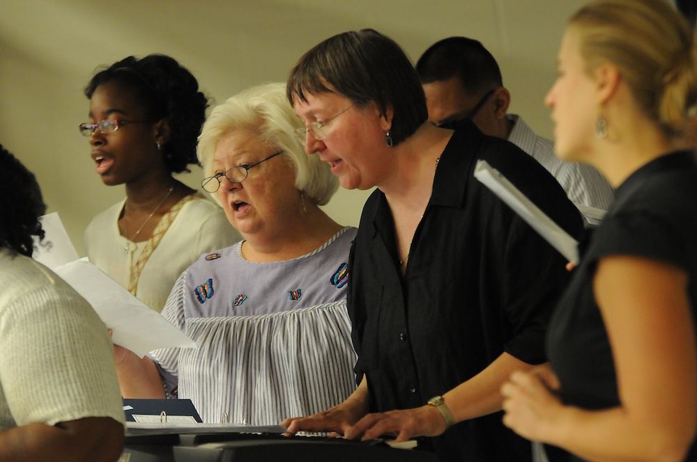 Mary Jameyfield (center to left), Sandy Constantine, and Evana James sing during the dedication ceremony of the new Immaculate Conception St. Joseph Middle School, 363 West Hill Street in Chicago on August 28, 2011 l Brian J. Morowczynski~ViaPhotos..For use in a single edition of Catholic New World Publications, Archdiocese of Chicago. Further use and/or distribution may be negotiated separately. ..Contact ViaPhotos at 708-602-0449 or email brian@viaphotos.com.   .