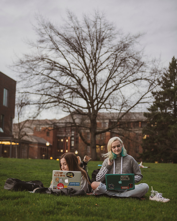 Estella and Cordilia, both 18 and from California, work outdoors on their MacBooks on the Univesity of Oregon campus in Eugene. (January 31, 2020)