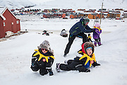 Children play in the snow on SolFest in Longyearbyen, Svalbard. The festival marks the official arrival of the sun to the town – by tradition, to the old hospital steps (sykehustrappa).