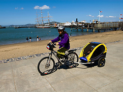 San Francisco: Mother and child bicycling at Fisherman's Wharf. Photo 12-casanf78317 Photo copyright Lee Foster.