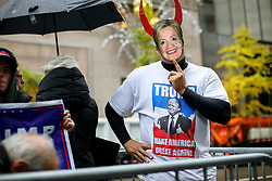 © Licensed to London News Pictures. 09/11/2016. New York CIty, USA. A pro-Trump supporters celebrate while gathering outside Trump Tower in New York City, on Wednesday, 9 November 2016 following the presidential election won by Donald Trump. Photo credit: Tolga Akmen/LNP