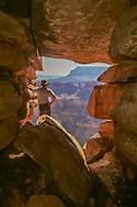 Man views Grand Canyon near Toroweap from a natural opening in a ridge along the south rim, MR, © David A. Ponton