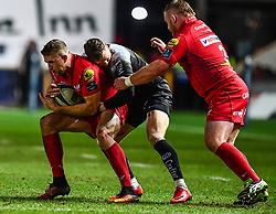 Scarlets' Tom Prydie is tackled by Toulon's Chris Ashton<br /> <br /> Photographer Craig Thomas/Replay Images<br /> <br /> European Rugby Champions Cup Round 5 - Scarlets v Toulon - Saturday 20th January 2018 - Parc Y Scarlets - Llanelli<br /> <br /> World Copyright © Replay Images . All rights reserved. info@replayimages.co.uk - http://replayimages.co.uk