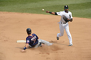 CHICAGO - SEPTEMBER 05:  Alexei Ramirez #10 of the Chicago White Sox turns a double play over the sliding Joe Mauer #7 of the Minnesota Twins on September 05 , 2012 at U.S. Cellular Field in Chicago, Illinois.  The White Sox defeated the Twins 6-2.  (Photo by Ron Vesely)  Subject:    Alexei Ramirez; Joe Mauer