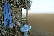 Camp bathroom <br /> <br /> The Sultanate of Oman is a country in Southwest Asia. It borders the United Arab Emirates in the northwest, Saudi Arabia in the west, and Yemen in the southwest.<br /> The oil discovery, in the 60's, started to transform this asleep country. Today, Oman is  torn by modern roads, industrialized and rich ( Omanization ). The tradition still dominates life of the 2,5 million inhabitants: strong religion ( muslim ), traces of tribal loyalties and a very characteristic culture.