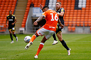 Wimbledon midfielder Scott Wagstaff (7) tries to block the clearance during the EFL Sky Bet League 1 match between Blackpool and AFC Wimbledon at Bloomfield Road, Blackpool, England on 20 October 2018.