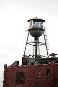 SHOT 10/5/15 11:56:25 AM - An old water tower atop a dilapidated manufacturing facility in Buffalo, N.Y. Buffalo is the second most populous city in the state of New York and is located in Western New York on the eastern shores of Lake Erie and at the head of the Niagara River. By 1900, Buffalo was the 8th largest city in the country, and went on to become a major railroad hub, the largest grain-milling center in the country and the home of the largest steel-making operation in the world. The latter part of the 20th Century saw a reversal of fortunes: by the year 1990 the city had fallen back below its 1900 population levels. (Photo by Marc Piscotty / © 2015)