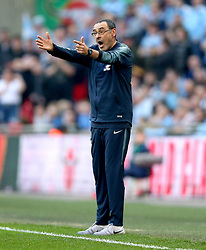 Chelsea manager Maurizio Sarri gestures on the touchline during the Carabao Cup Final at Wembley Stadium, London.