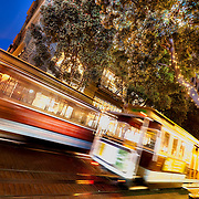 Intersection of Powell and Ellis Streets in Union Square area of downtown San Francisco, CA. Streetcar motion at dusk on Powell St.