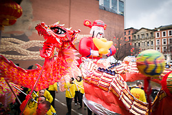 © Licensed to London News Pictures . 26/01/2020. Manchester, UK. A dragon dances in front of crowds in China Town . Thousands of people watch a display of oriental culture and a procession through Manchester city centre to mark Chinese New Year . Photo credit: Joel Goodman/LNP