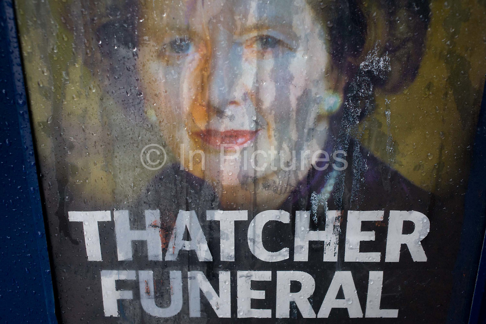 The face of ex-British Prime Minister Margaret Thatcher printed on a newspaper souvenir issue is rain streaked the day after her ceremonial funeral was held in central London. Afforded a ceremonial funeral with military honours, not seen since the death of Winston Churchill in 1965, family and 2,000 VIP guests (incl Queen Elizabeth) await her cortege. Margaret Hilda Thatcher, Baroness Thatcher (1925- 2013) was a British politician who was thePrime Minister of the United Kingdomfrom 1979 to 1990 and theLeader of the Conservative Partyfrom 1975 to 1990, the longest-serving British Prime Minister of the 20th century and the only woman to have held the office to date.