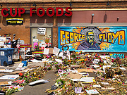 """12 JUNE 2020 - MINNEAPOLIS, MINNESOTA: The impromptu community memorial for George Floyd at the corner of 38th Street and Chicago Ave. in Minneapolis. The intersection is informally known as """"George Floyd Square"""" and is considered a """"police free zone."""" There are memorials to honor Black people killed by police and people providing free food at the intersection. Floyd, an unarmed Black man, was killed by Minneapolis police on May 25 when an officer kneeled on his neck for 8 minutes and 46 seconds. Floyd's death sparked weeks of ongoing protests and uprisings against police violence around the world.          PHOTO BY JACK KURTZ"""