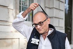 © Licensed to London News Pictures. 30/08/2019. London, UK. Government special advisor Dominic Cummings removes his pass lanyard as he arrives at Downing Street. The government has asked the Queen to suspend Parliament in the days after MPs return to work in September - a few weeks before the Brexit deadline of October 31st. Photo credit: Peter Macdiarmid/LNP
