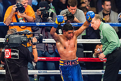 LOS ANGELES, CA - DEC 15: Former Unified Super Lightweight World Champion Amir 'King' Khan celebreates after stopping Carlos Molina in the 10th round of their bout at the Los Angeles Memorial Sports Arena in Los Angeles, CA 2012/12/15. Amir Khan defeated Carlos Molina by TKO, after referee Jack Reiss stopped the fight after the 10th round after consulting with Molina and his corner. Byline and/or web usage link must  read PHOTO: © 2012 Eduardo E. Silva/SILVEX.PHOTOSHELTER.COM.