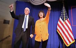 Republican vice presidential candidate Mike Pence, with his wife Karen, responds to cheering supporters as he takes the stage at a rally Monday, Oct. 31, 2016 in Maitland, Fla., near Orlando. (Joe Burbank/Orlando Sentinel/TNS)