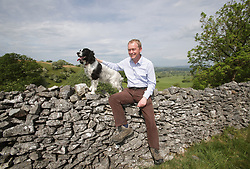 File photo dated 27/05/17 of Liberal Democrats leader Tim Farron and his 5-year-old Springer Spaniel Jasper during a walkabout with the media in Scout Scar in the Lake District, Cumbria.