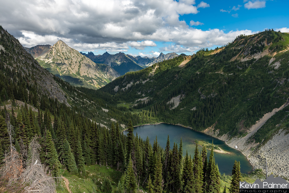 The views of Ann Lake in the North Cascades kept getting better as I climbed up to Heather Pass. But sunlight was getting scarce as rain showers moved in.