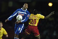 Photo: Jonathan Butler.<br />Watford v Stockport County. The FA Cup. 06/01/2007.<br />Tes Bramble of Stockport out jumps Al Bangura of Watford.