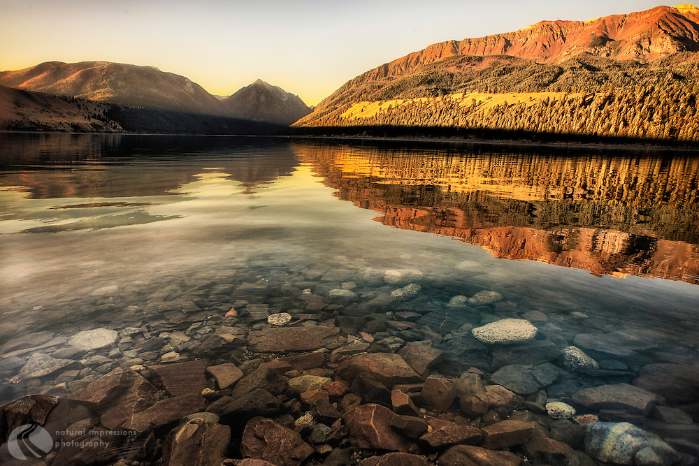 Chief Joseph Mountain, on the right, casts an early morning reflection into Wallowa Lake.