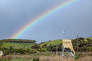 Rainbow over the Israeli flag. Photographed at the Isle of Peace at the (now unused) Naharaim Hydroelectric plant on the Israeli Jordanian border.